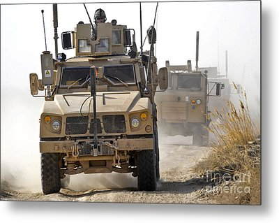A U.s. Army M-atv Leads A Convoy Metal Print by Stocktrek Images