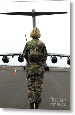 An Airfield Manager Greets An Arriving Metal Print by Stocktrek Images