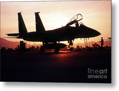 An F-15c Eagle Aircraft Silhouetted Metal Print by Stocktrek Images
