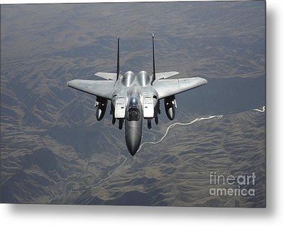 An F-15e Strike Eagle Flies Watch Metal Print by Stocktrek Images