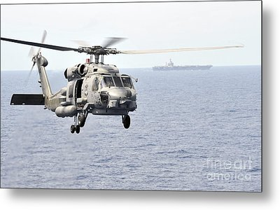 An Mh-60r Seahawk Helicopter In Flight Metal Print by Stocktrek Images