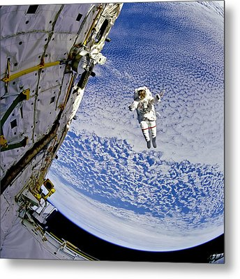 Astronaut In Atmosphere Metal Print by The  Vault - Jennifer Rondinelli Reilly