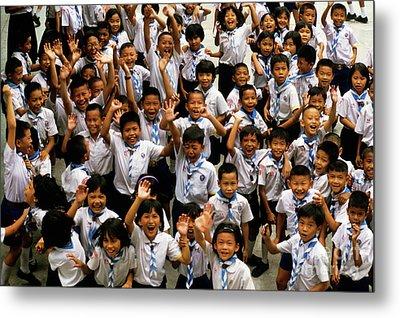 Bangkok School Children Jumping And Smiling At The Camera Metal Print by Sami Sarkis