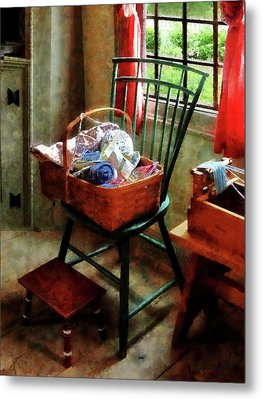 Basket Of Cloth And Yarn On Chair Metal Print by Susan Savad