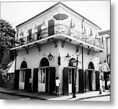 Bienville And Bourbon Streets  Metal Print by Allan McConnell