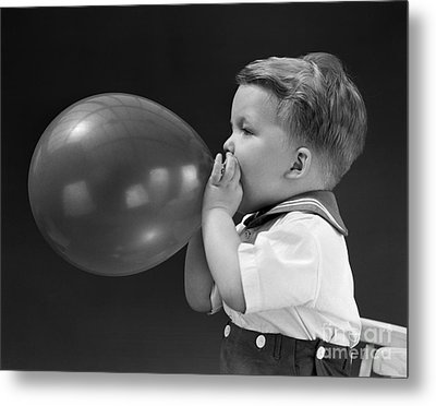 Boy Blowing Up Balloon, C.1940s Metal Print by H. Armstrong Roberts/ClassicStock