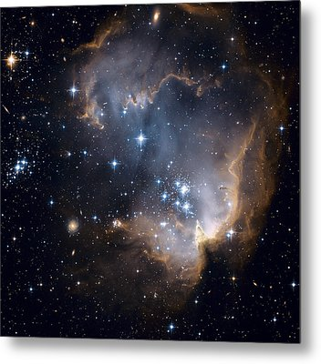 Bright Blue Newborn Stars Blast A Hole Metal Print by ESA and nASA