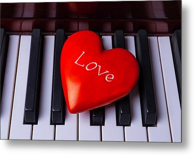 Bright Red Heart On Piano Keys Metal Print by Garry Gay