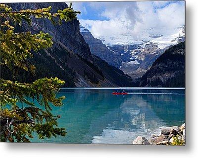 Canoe On Lake Louise Metal Print by Larry Ricker