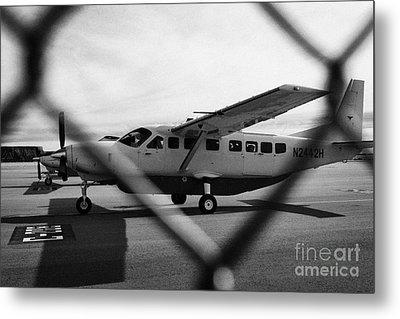 cessna 208B sightseeing tour aircraft at Grand canyon west airport Arizona USA Metal Print by Joe Fox