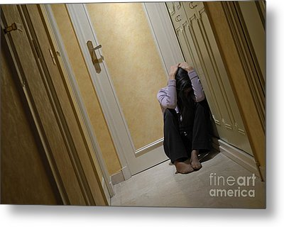 Depressed Woman Sitting In Corridor With Head In Hands Metal Print by Sami Sarkis