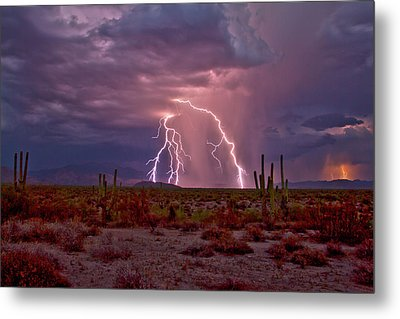 Dueling Storms Metal Print by Cathy Franklin
