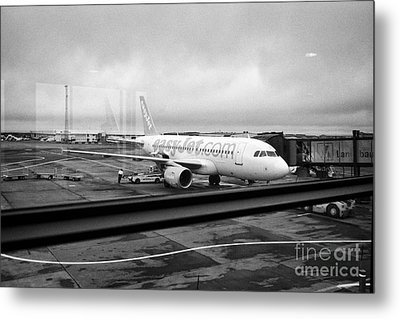 easyjet aircraft on stand at departures gate Keflavik airport looking through the window glass Icela Metal Print by Joe Fox