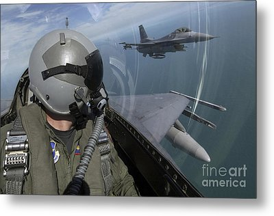 F-16 Fighting Falcons Flying Metal Print by Stocktrek Images