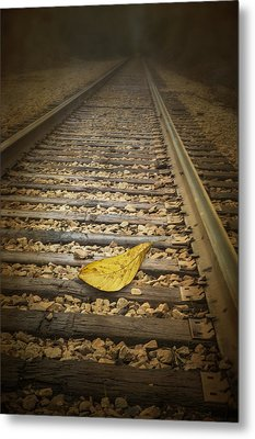 Fallen Yellow Autumn Leaf On The Railroad Tracks Metal Print by Randall Nyhof