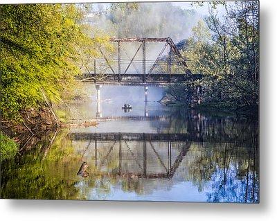 Fishing Under The Trestle Metal Print by Debra and Dave Vanderlaan