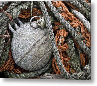 Float And Fishing Nets Metal Print by Carol Leigh