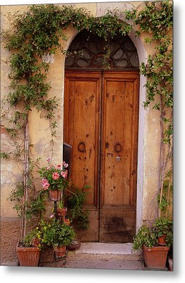 Flowered Tuscan Door Metal Print by Donna Corless