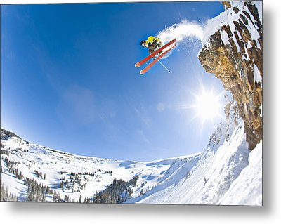 Freestyle Skier Jumping Off Cliff Metal Print by Tyler Stableford