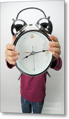 Girl Holding Alarm Clock Over Face Metal Print by Sami Sarkis