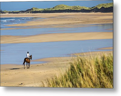 Horse And Rider On Beach With Grassy Metal Print by Michael Interisano