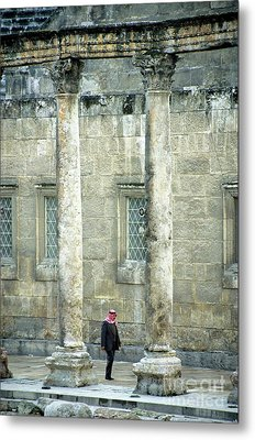 Man Walking Between Columns At The Roman Theatre Metal Print by Sami Sarkis