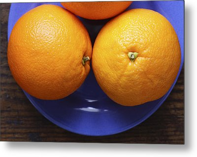 Naval Oranges On Blue Plate Metal Print by Donald Erickson