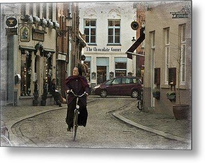 Nun On A Bicycle In Bruges Metal Print by Joan Carroll