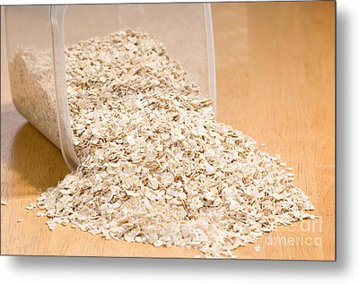 Oat Flakes Spilled Out Of Plastic Container  Metal Print by Arletta Cwalina
