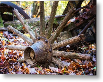 Old Decaying Wagon Wheel Metal Print by Tom Mc Nemar