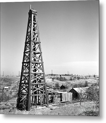 Old Wooden Derrick Metal Print by Larry Keahey