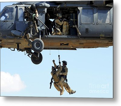 Pararescuemen Are Hoisted Into An Hh-60 Metal Print by Stocktrek Images