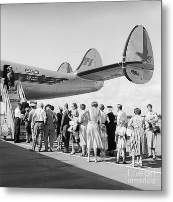 Passengers Boarding A Plane Metal Print by C.S. Bauer/ClassicStock