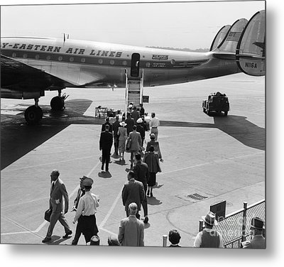 Passengers Boarding A Plane Metal Print by H. Armstrong Roberts/ClassicStock