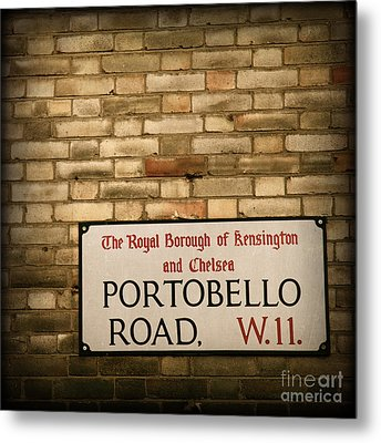 Portobello Road Sign On A Grunge Brick Wall In London England Metal Print by ELITE IMAGE photography By Chad McDermott