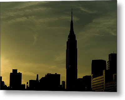 Silhouette Of Empire State Building Metal Print by Todd Gipstein