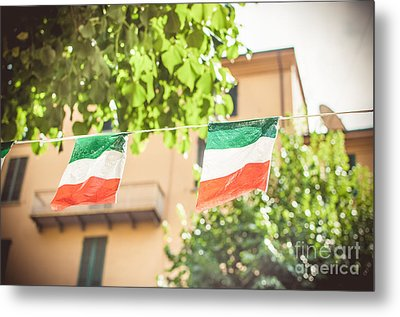 small Italian flags hanging by a thread Metal Print by Luca Lorenzelli