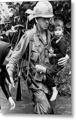 Soldier Carrying Boy Metal Print by Underwood Archives