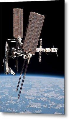 Space Shuttle Endeavor Docked Metal Print by Everett