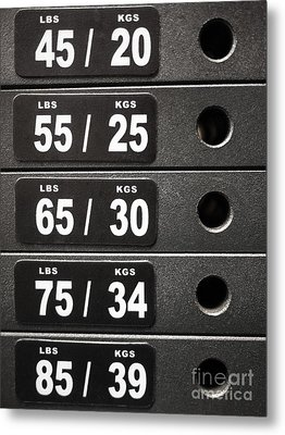 Stack Of Weight Plates  On Gym Equipment Metal Print by Paul Velgos