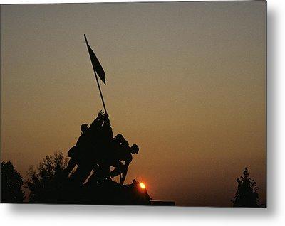 The Iwo Jima Memorial Silhouetted Metal Print by Kenneth Garrett