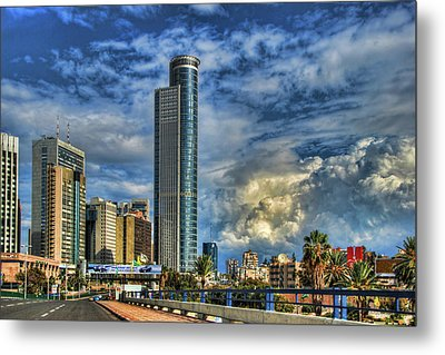 The Skyscraper And Low Clouds Dance Metal Print by Ron Shoshani