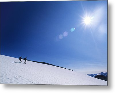 Two Hikers Explore A Snowfield Metal Print by Bill Hatcher