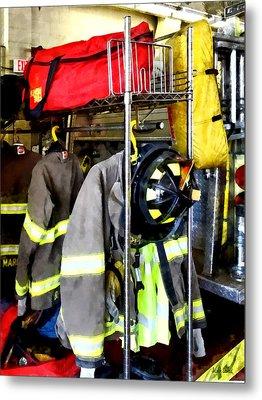 Uniforms Inside Firehouse Metal Print by Susan Savad