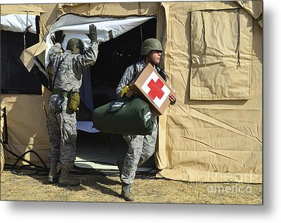 U.s. Air Force Soldier Exits A Medical Metal Print by Stocktrek Images