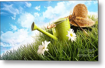 Water Can And Straw Hat Laying In Grass Metal Print by Sandra Cunningham