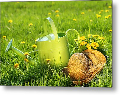 Watering Can In The Grass Metal Print by Sandra Cunningham