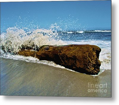 Waves Splashing Over Driftwood On Beach Metal Print by Amanda Nicholls