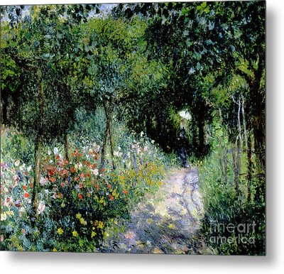 Woman In A Garden Metal Print by Pierre Auguste Renoir