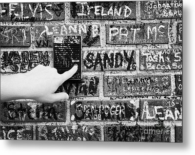 Womans Hand Pushing Old Intercom Button On Wall Covered In Graffiti Outside Graceland Memphis Metal Print by Joe Fox